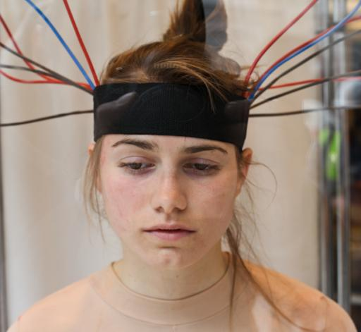 electrical wires connected to her head