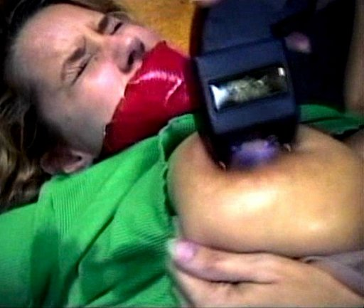 stun gun to the nipple of a gagged girl