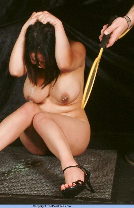 captive woman spanked and tormented with an electric fly swatter paddle